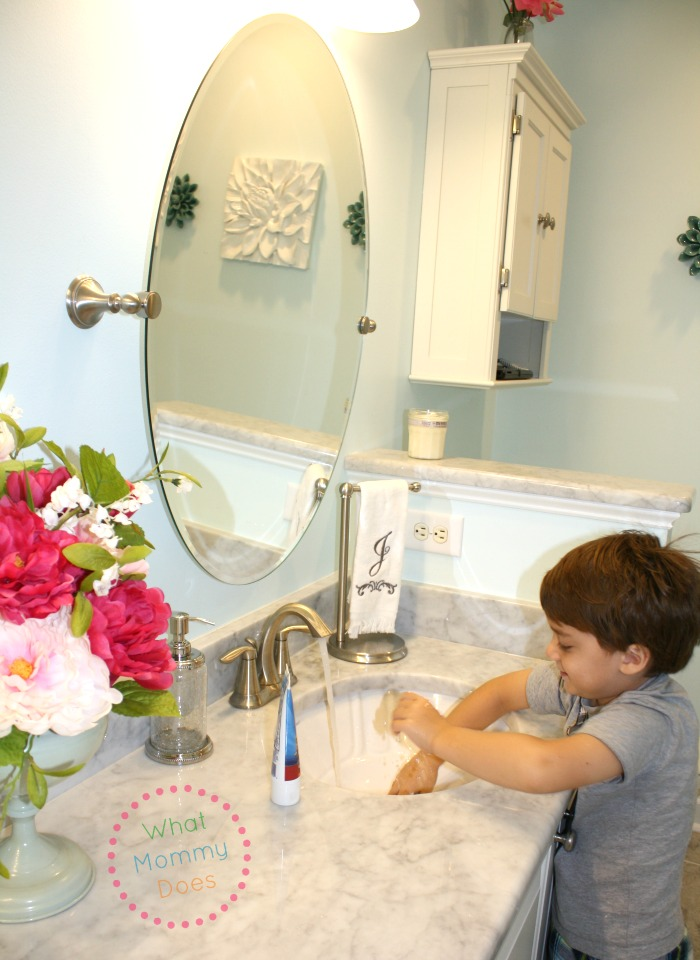 julian playing in sink