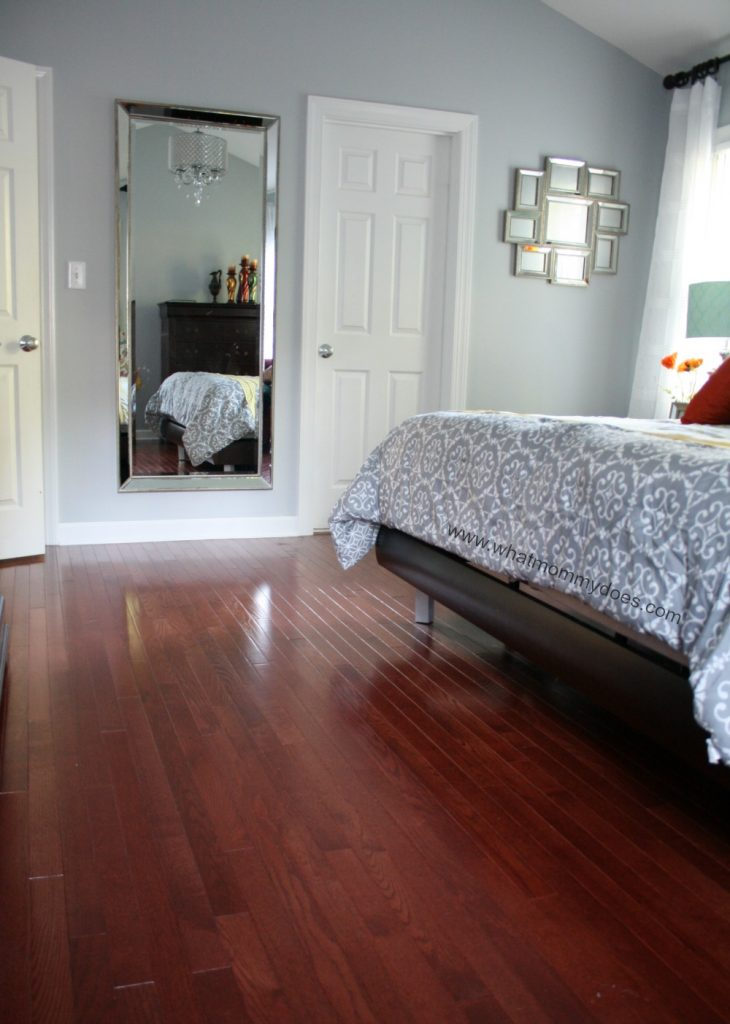 Old dog carpet BE GONE! Click to learn how these beautiful hardwood floors help cut down on dust allergies! Hardwood floor cleaning is so much easier to maintain than carpet. | master bedroom makeover ideas & tips